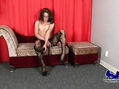 Lovely shemale Poison is sensually stripping for camera.