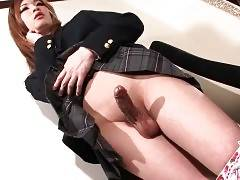 Naughty japanese tranny gets her dick rubbed.